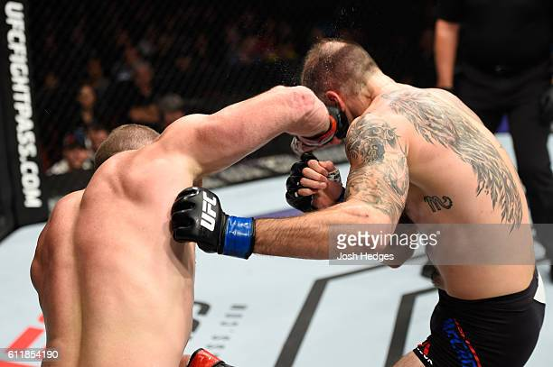 Nate Marquardt punches Tamdan McCrory in their middleweight bout during the UFC Fight Night event at the Moda Center on October 1 2016 in Portland...