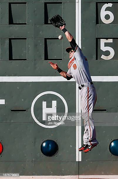 Nate McLouth of the Baltimore Orioles is unable to catch a onerun double hit by Scott Podsednik of the Boston Red Sox in the eighth inning at Fenway...