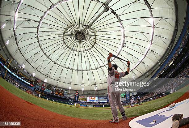 Nate McLouth of the Baltimore Orioles stretches before an at bat during a game against the Tampa Bay Rays at Tropicana Field on September 21, 2013 in...