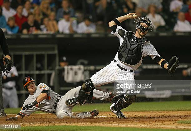 Nate McLouth of the Baltimore Orioles takes down Tyler Flowers of the Chicago White Sox as Flowers tries to turn a double play in the 9th inning at...