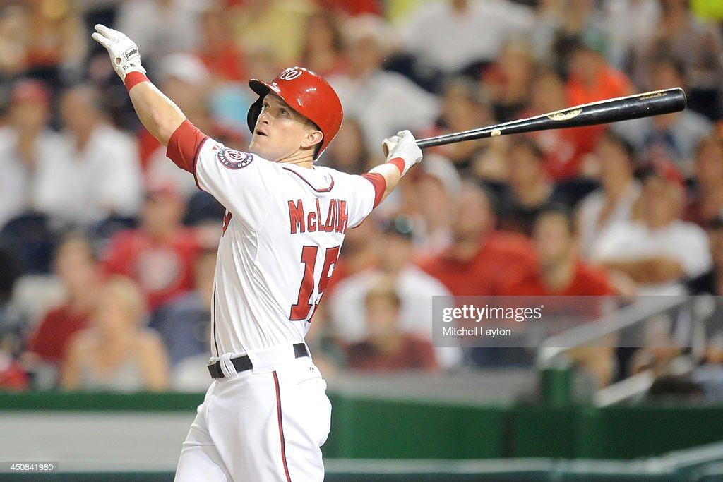 Nate McLouth #15 of the Washington Nationals hits a sacrifice fly in the seventh to score the winning run during a baseball game against the Houston Astros on June 18, 2014 at Nationals Park in Washington, DC. The Nationals won 6-5.