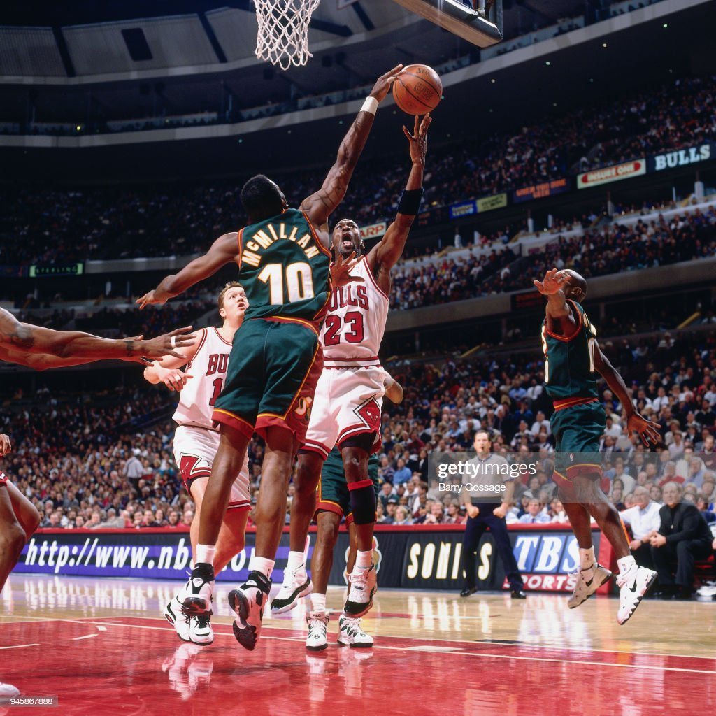 Nate McMillan of the Seattle SuperSonics contests the shot