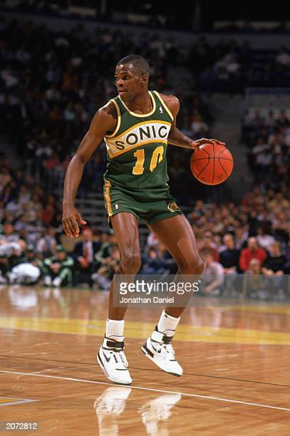 Nate McMillan of the Seattle Supersonics dribbles the ball during the 19881989 NBA season game against the Milwaukee Bucks at The Bradley Center in...
