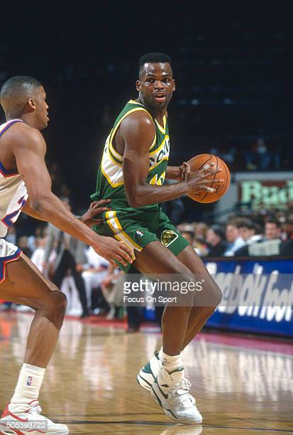 Nate McMillan of the Seattle Supersonics looks to pass the ball against the Washington Bullets during an NBA basketball game circa 1993 at US Airways...