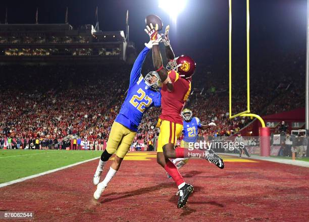 Nate Meadors of the UCLA Bruins breaks up a pass to Steven Mitchell Jr #4 of the USC Trojans during the second quarter at Los Angeles Memorial...