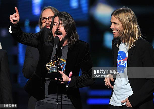 Nate Mendel Dave Grohl and Taylor Hawkins of Foo Fighters accept the award for 'Best Rock Performance' onstage at the 54th Annual GRAMMY Awards held...
