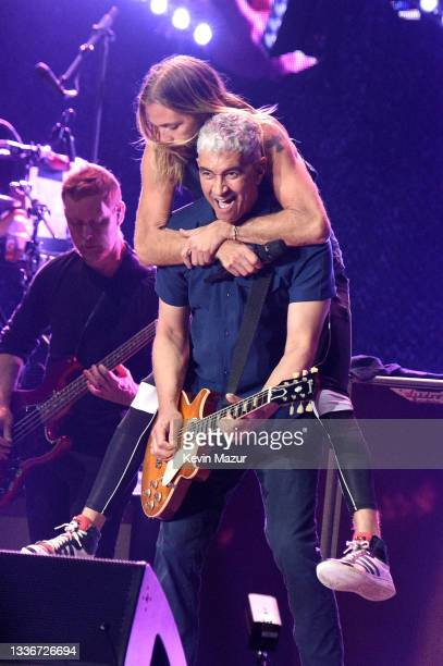 Nate Mendel, Taylor Hawkins, and Pat Smear of Foo Fighters perform onstage at The Forum on August 26, 2021 in Inglewood, California.