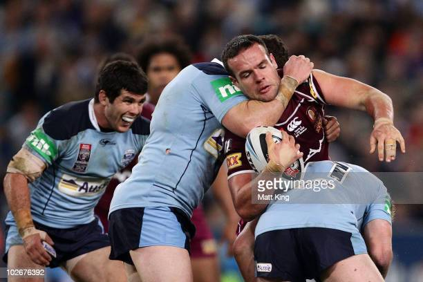 Nate Myles of the Maroons is tackled during game three of the ARL State of Origin series between the New South Wales Blues and the Queensland Maroons...