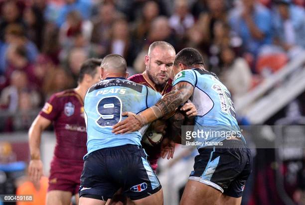 Nate Myles of the Maroons takes on the defence during game one of the State Of Origin series between the Queensland Maroons and the New South Wales...