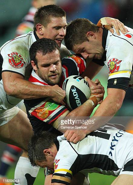 Nate Myles of the Roosters is tackled during the round 13 NRL match between the Sydney Roosters and the Warriors at Sydney Football Stadium on June 4...