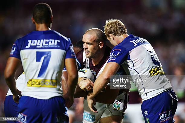 Nate Myles of the Sea Eagles is tackled during the round one NRL match between the Manly Warringah Sea Eagles and the Canterbury Bulldogs at...