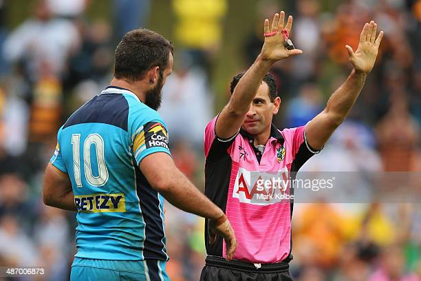 Nate Myles of the Titans is given ten in the bin by referee Gerard Sutton during the round 8 NRL match between the Wests Tigers and the Gold Coast...