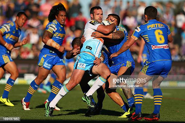 Nate Myles of the Titans is tackled during the round 11 NRL match between the Parramatta Eels and the Gold Coast Titans at Glen Willow Regional...