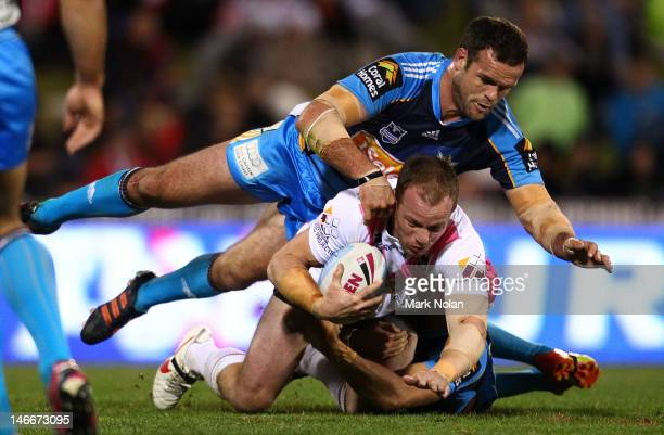 Nate Myles of the Titans tackles Beau Scott of the Dragons during the round 16 NRL match between the St George Illawarra Dragons and the Gold Coast...
