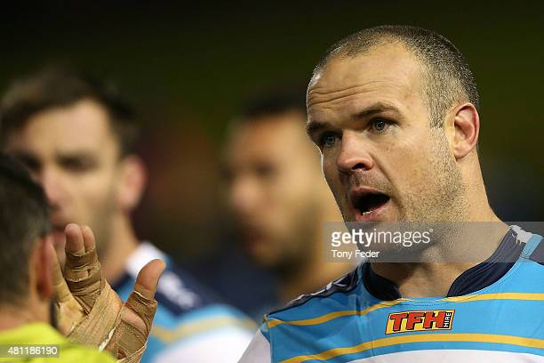 Nate Myles of the Titans talks to the referee during the round 19 NRL match between the Newcastle Knights and the Gold Coast Titans at Hunter Stadium...
