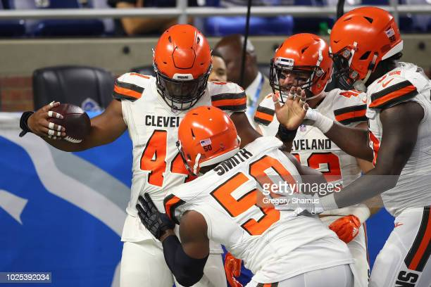 Nate Orchard of the Cleveland Browns celebrates a second quarter touchdown with teammates after intercepting a pass while playing the Detroit Lions...