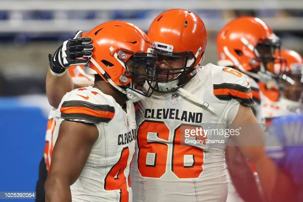Nate Orchard of the Cleveland Browns celebrates a second quarter touchdown with Spencer Drango after intercepting a pass while playing the Detroit...