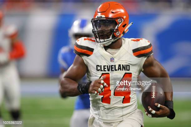 Nate Orchard of the Cleveland Browns runs for a second quarter touchdown after intercepting a pass while playing the Detroit Lions during a preseason...