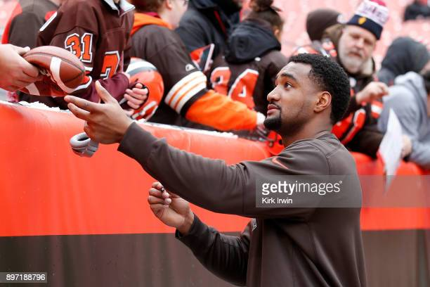 Nate Orchard of the Cleveland Browns signs an autograph for a fan prior to the start of the game against the Baltimore Ravens at FirstEnergy Stadium...