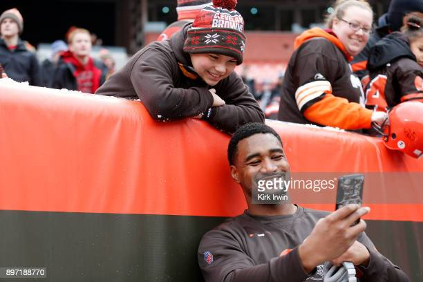 Nate Orchard of the Cleveland Browns takes a selfie with a fan prior to the start of the game against the Baltimore Ravens at FirstEnergy Stadium on...