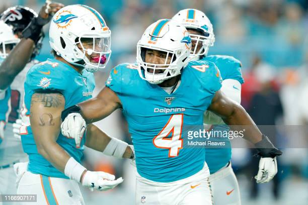 Nate Orchard of the Miami Dolphins reacts after a sack against the Atlanta Falcons during the first quarter of the preseason game at Hard Rock...