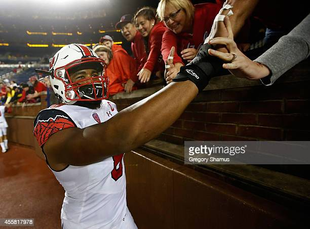 Nate Orchard of the Utah Utes high fives fans fans after a 26-10 win over the Michigan Wolverines on September 20, 2014 at Michigan Stadium in Ann...