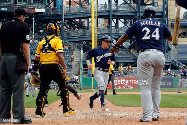 Nate Orf of the Milwaukee Brewers scores on a three RBI triple in the eighth inning against the Pittsburgh Pirates at PNC Park on July 15 2018 in...