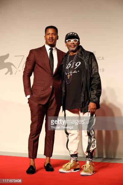 "Nate Parker and Spike Lee walk the red carpet ahead of the ""American Skin"" screening during the 76th Venice Film Festival at Sala Giardino on..."