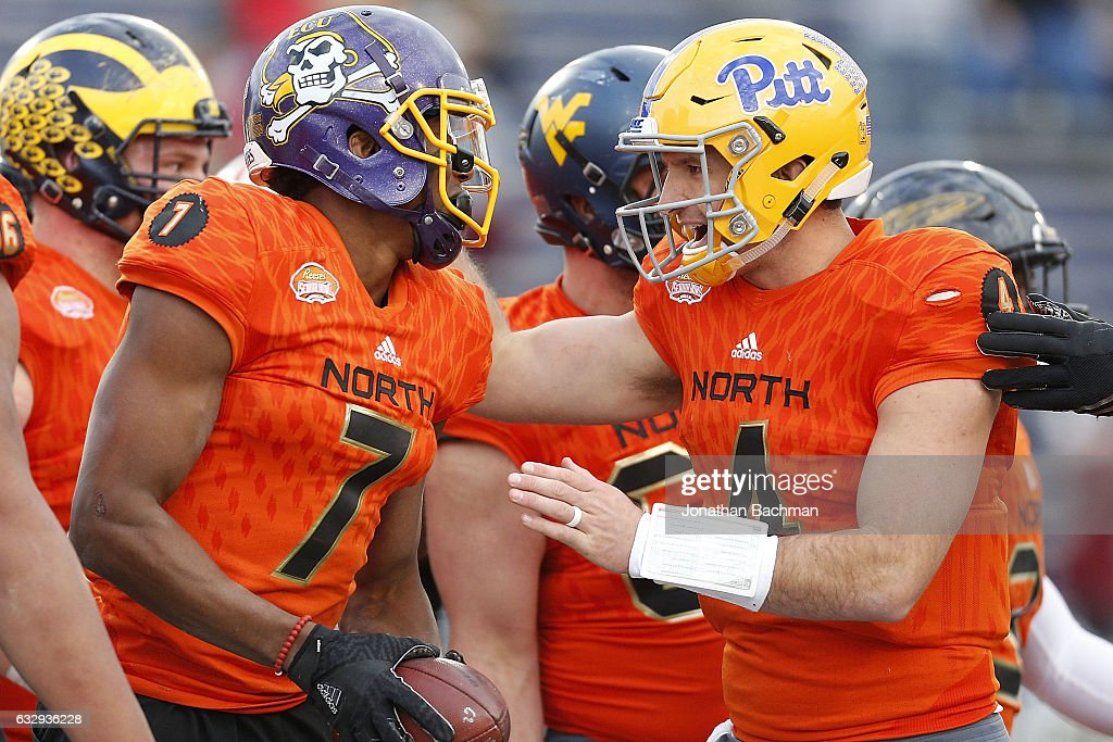 Nate Peterman #4 of the North team celebrates with Zay Jones #7 of the North team during the second half of the Reese's Senior Bowl at the Ladd-Peebles Stadium on January 28, 2017 in Mobile, Alabama.