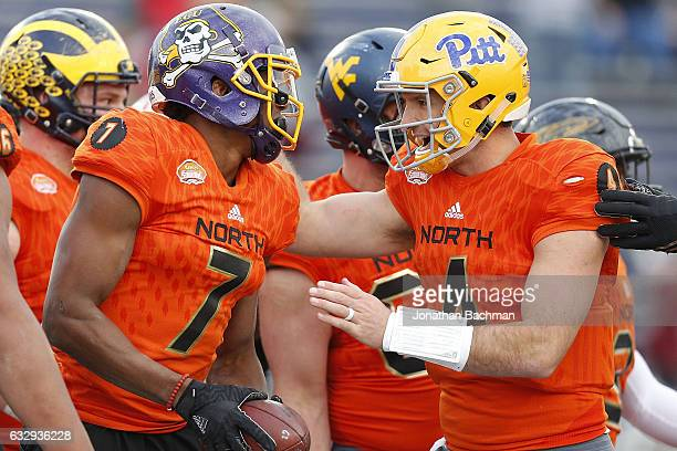 Nate Peterman of the North team celebrates with Zay Jones of the North team during the second half of the Reese's Senior Bowl at the LaddPeebles...