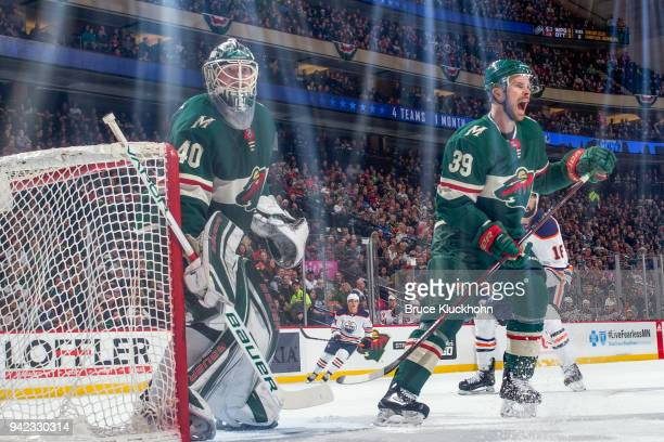 Nate Prosser and Devan Dubnyk of the Minnesota Wild defend against the Edmonton Oilers during the game at the Xcel Energy Center on April 2 2018 in...