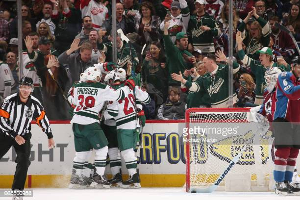Nate Prosser and Ryan Suter of the Minnesota Wild celebrate a goal by Nino Niederreiter against the Colorado Avalanche at the Pepsi Center on April 6...
