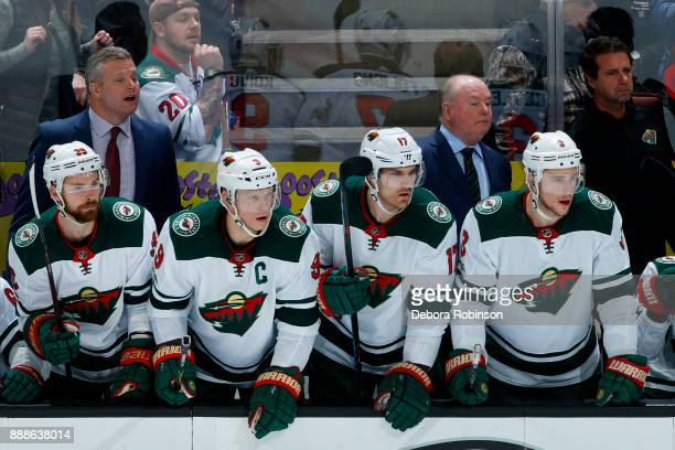 Nate Prosser Charlie Coyle Marcus Foligno and Charlie Coyle of the Minnesota Wild watch the game against the Anaheim Ducks from the bench on December...