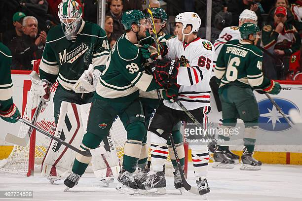 Nate Prosser of the Minnesota Wild and Andrew Shaw of the Chicago Blackhawks shove each other after the whistle during the game on February 3 2015 at...
