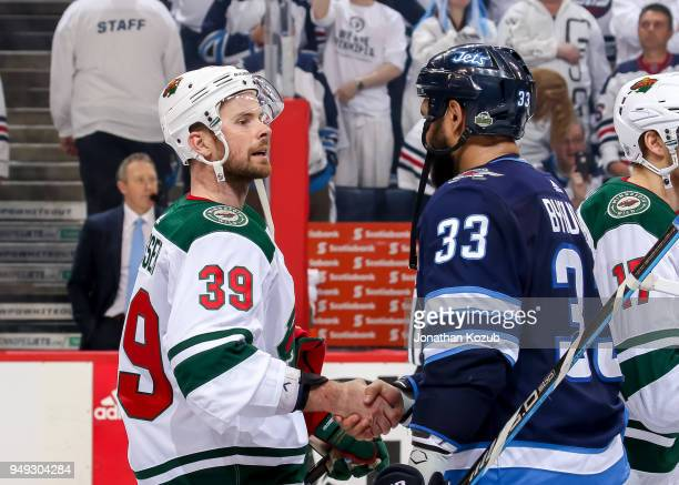 Nate Prosser of the Minnesota Wild and Dustin Byfuglien of the Winnipeg Jets shake hands following a 50 victory in Game Five of the Western...