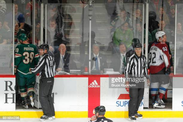 Nate Prosser of the Minnesota Wild and Gabriel Landeskog of the Colorado Avalanche are escorted to the penalty box after receiving roughing penalties...