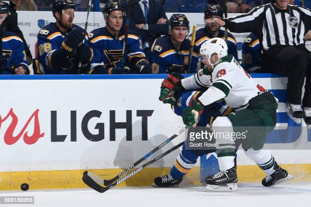 Nate Prosser of the Minnesota Wild and Jaden Schwartz of the St Louis Blues battle for the puck in Game Three of the Western Conference First Round...
