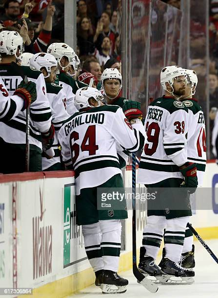 Nate Prosser of the Minnesota Wild and the rest of his teammates react after the overtime loss to the New Jersey Devils on October 22 2016 at...