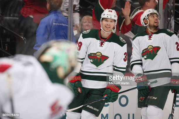 Nate Prosser of the Minnesota Wild celebrates after scoring a goal against the Colorado Avalanche at the Pepsi Center on April 6 2017 in Denver...