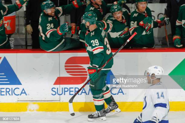 Nate Prosser of the Minnesota Wild celebrates after scoring a goal against the Tampa Bay Lightning during the game at the Xcel Energy Center on...