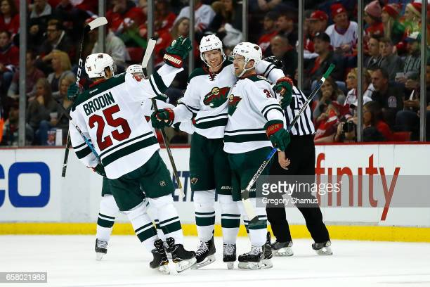 Nate Prosser of the Minnesota Wild celebrates his second period goal with Eric Staal and Jonas Brodin while playing the Detroit Red Wings at Joe...