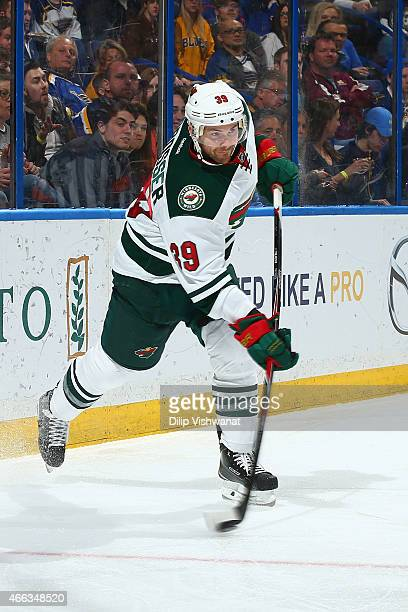 Nate Prosser of the Minnesota Wild clears the puck against the St Louis Blues at the Scottrade Center on March 14 2015 in St Louis Missouri