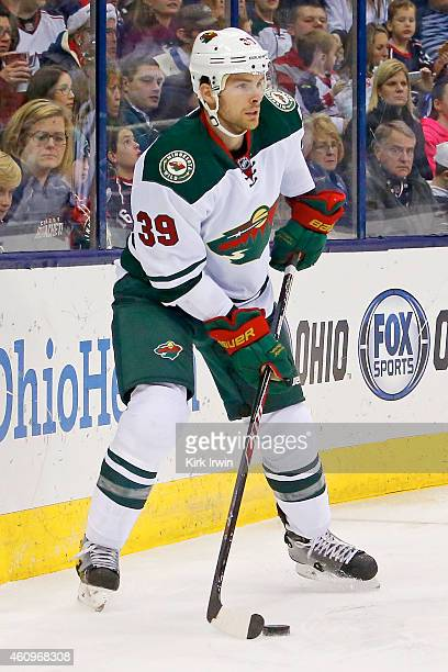 Nate Prosser of the Minnesota Wild controls the puck during the game against the Columbus Blue Jackets on December 31 2014 at Nationwide Arena in...