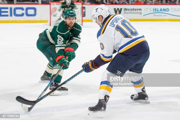 Nate Prosser of the Minnesota Wild defends Scottie Upshall of the St Louis Blues in Game Five of the Western Conference First Round during the 2017...