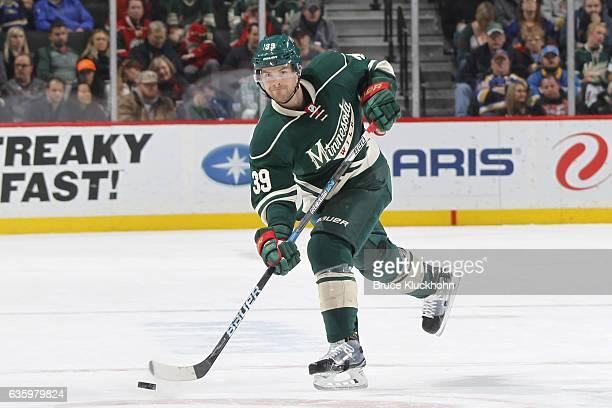 Nate Prosser of the Minnesota Wild dumps the puck against the St Louis Blues during the game on December 11 2016 at the Xcel Energy Center in St Paul...