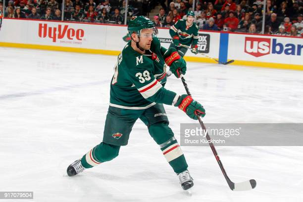 Nate Prosser of the Minnesota Wild dumps the puck against the Vegas Golden Knights during the game at the Xcel Energy Center on February 2 2018 in St...