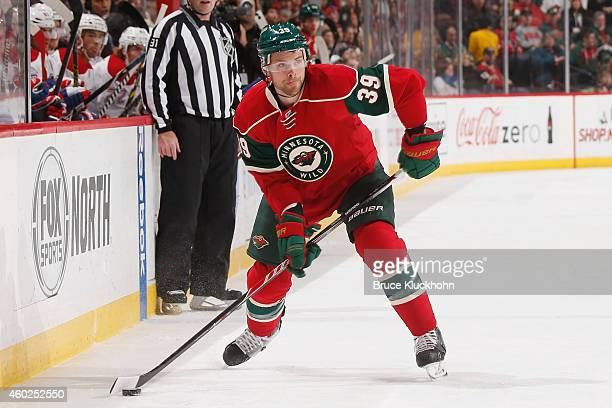 Nate Prosser of the Minnesota Wild handles the puck against the Montreal Canadiens during the game on December 3 2014 at the Xcel Energy Center in St...