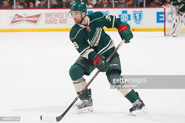 Nate Prosser of the Minnesota Wild handles the puck against the Dallas Stars during the game on February 22 2015 at the Xcel Energy Center in St Paul...