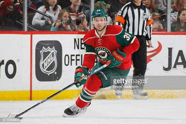 Nate Prosser of the Minnesota Wild handles the puck against the Boston Bruins during the game on February 13 2016 at the Xcel Energy Center in St...