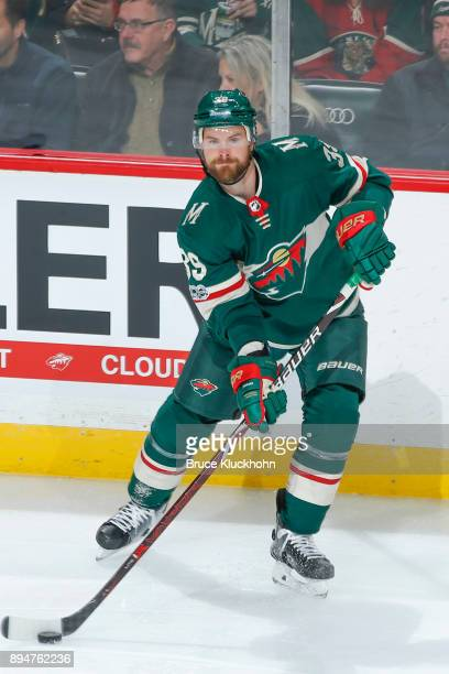 Nate Prosser of the Minnesota Wild handles the puck against the Calgary Flames during the game at the Xcel Energy Center on December 12 2017 in St...